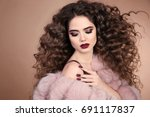 hairstyle. curly hair. beauty... | Shutterstock . vector #691117837