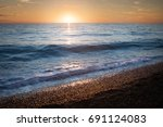 seascape. waves on the beach at ... | Shutterstock . vector #691124083