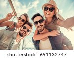 cheerful young people are... | Shutterstock . vector #691132747