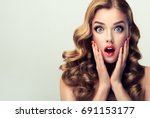 woman with ren lips and nails... | Shutterstock . vector #691153177