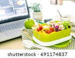 close up green lunch box on... | Shutterstock . vector #691174837