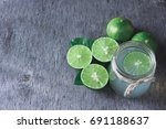 water detox with lime on a dark ... | Shutterstock . vector #691188637