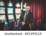 elegant man near slots machines ... | Shutterstock . vector #691193113