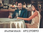 beautiful couple in a restaurant | Shutterstock . vector #691193893