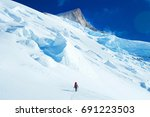 climber with backpacks reaches... | Shutterstock . vector #691223503