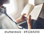 male passenger killing time by... | Shutterstock . vector #691264243
