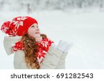 little girl in red cap catching ... | Shutterstock . vector #691282543