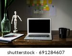 dark wood working table in... | Shutterstock . vector #691284607