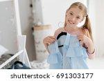 adorable girl choosing her...   Shutterstock . vector #691303177