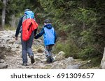 father and son hiking together... | Shutterstock . vector #691309657