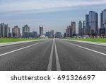 city road through modern... | Shutterstock . vector #691326697