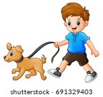 Stock photo little boy walking with his dog 691329403