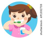 a little girl happy to brush... | Shutterstock .eps vector #691332733