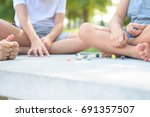 kids playing marbles game... | Shutterstock . vector #691357507