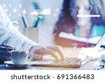 blurry male hand using laptop... | Shutterstock . vector #691366483