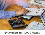 businessman using a calculator... | Shutterstock . vector #691370383