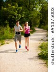active young couple running in...   Shutterstock . vector #691375003