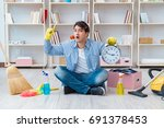 man doing cleaning at home | Shutterstock . vector #691378453
