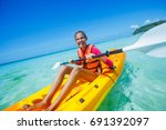 beautiful girl with kayak... | Shutterstock . vector #691392097