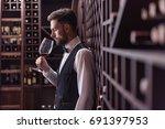 young handsome man sommelier...   Shutterstock . vector #691397953