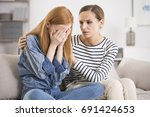 young depressed woman crying... | Shutterstock . vector #691424653