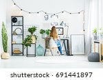 young girl with long hair sits... | Shutterstock . vector #691441897