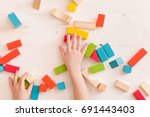 top view on child's hands... | Shutterstock . vector #691443403