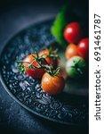 tomatoes in dark mood | Shutterstock . vector #691461787