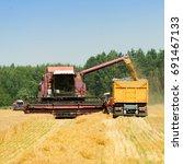 harvester combine harvesting... | Shutterstock . vector #691467133