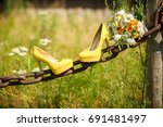 yellow wedding shoes | Shutterstock . vector #691481497