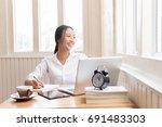 woman working on desk hand... | Shutterstock . vector #691483303