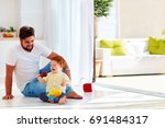 happy toddler baby playing with ... | Shutterstock . vector #691484317