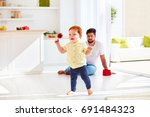happy toddler baby playing with ...   Shutterstock . vector #691484323