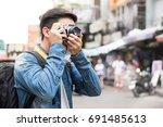traveling asian male tourist... | Shutterstock . vector #691485613