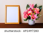 empty photo frame with flower...   Shutterstock . vector #691497283