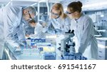 team of medical research... | Shutterstock . vector #691541167