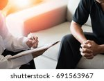 doctor physician consulting... | Shutterstock . vector #691563967