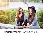 portrait of two beautiful young ... | Shutterstock . vector #691574947