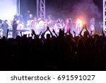 rear view of crowd with arms... | Shutterstock . vector #691591027