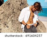 portrait of handsome sunbathed...   Shutterstock . vector #691604257