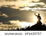fighter with a sword silhouette ... | Shutterstock . vector #691620757