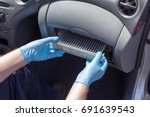 replacing the cabin air filter | Shutterstock . vector #691639543