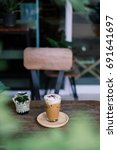 iced coffee on wooden table. | Shutterstock . vector #691641697
