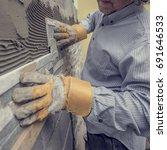 closeup of manual worker in... | Shutterstock . vector #691646533
