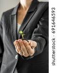 businesswoman holding a... | Shutterstock . vector #691646593