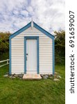 Colorful Painted Beach Hut On...