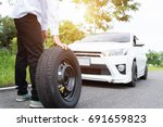 asian man with a white car that ...   Shutterstock . vector #691659823