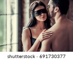 young couple is kissing and... | Shutterstock . vector #691730377