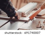 a carpenter works on... | Shutterstock . vector #691740007