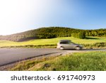 car on country road in norway ... | Shutterstock . vector #691740973